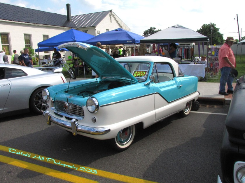 This is a Nash Metropolitan and yes baby blue is still a blue. I had to wear a Tux that color once..shiver.